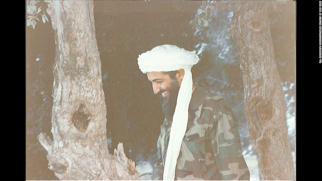 Bin Laden laughs during a walk.