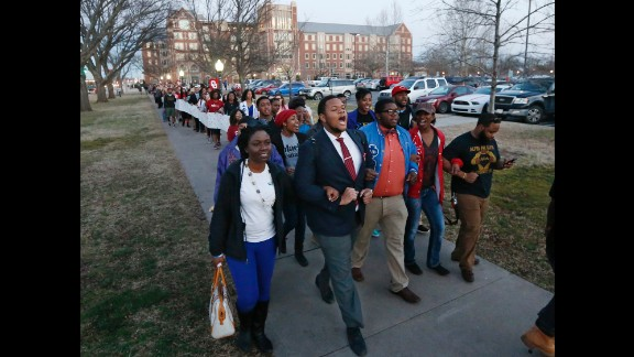 University of Oklahoma students march to the now-closed fraternity house of Sigma Alpha Epsilon during a rally in Norman, Oklahoma, on Tuesday, March 10. The university's president expelled two students Tuesday after he said they were identified as leaders of a racist chant that was captured on video.