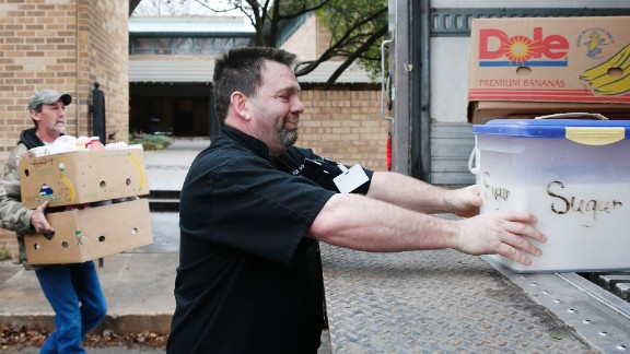 Steve Joule, executive chef at the City Rescue Mission, loads a container of sugar from the kitchen of the SAE house in Norman on March 10. The fraternity is donating its food to the mission after its house was shut down by the university.