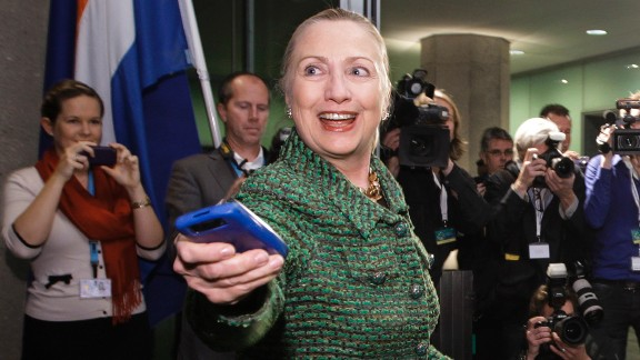 Clinton hands off her phone after arriving to meet with Dutch Foreign Minister Uri Rosenthal in The Hague, Netherlands, in December 2011.