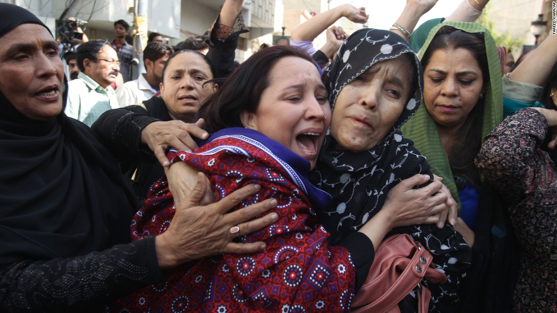 Pakistani women react to the arrest of their family members during a raid at the offices of the MQM headquarters in Karachi.
