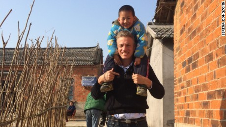 Six-year-old Lu Yiming and CNN Correspondent David McKenzie