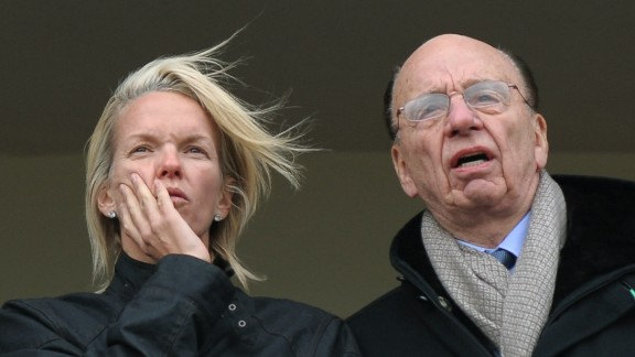 Chipping Norton resident Elisabeth Murdoch, pictured with her father media mogul Rupert Murdoch, on a balcony overlooking horse racing at Cheltenham in 2010.
