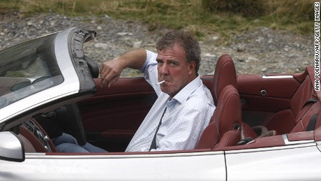 British television BBC presenter of motor show 'Top Gear' Jeremy Clarkson is pictured while he drives an Aston Martin car on Transfagarasan road close to Sibiu city, 300 km northwest from Bucharest, on September 24, 2009. The three presenters, Jeremy Clarkson, Richard Hammond and James May will drive the latest models of Ferrari, Aston Martin and Lamborghini on different roads and cities in Romania as Bucharest, Vidraru dam, Danube Delta and seacoast of Black Sea. AFP PHOTO ANA POENARIU
