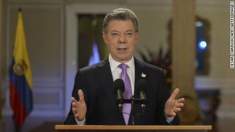 Handout picture released by Colombia's Presidential press office showing Colombian President Juan Manuel Santos addressing the nation at Narino Presidential Palace in Bogota, on March 10, 2015. Colombia's military will temporarily cease bombing raids against Marxist FARC rebels for a month, President Santos announced. The development is a major stride in Colombia's peace process aimed at ending Latin America's longest-running civil war.