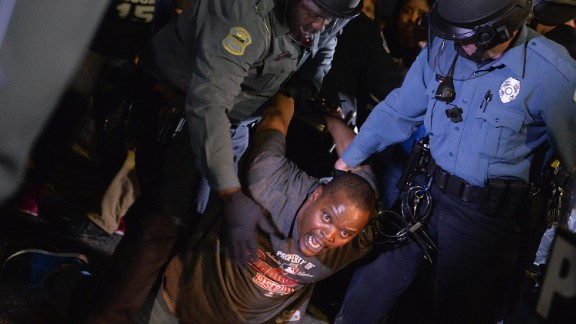 A demonstrator is detained and arrested during the March 11 protest.