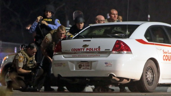 Police mobilize in the parking lot after shots were fired on March 12.