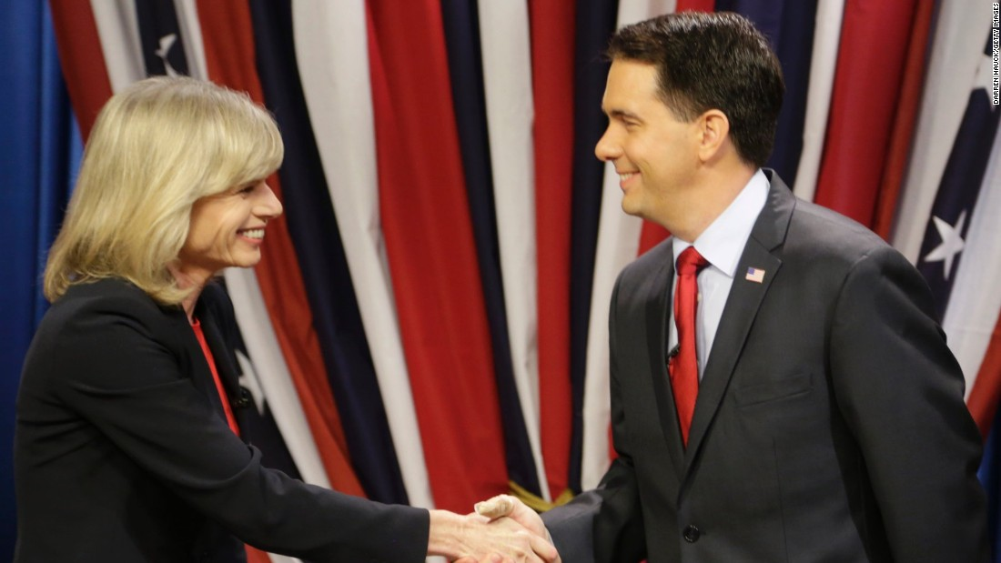 Walker shakes hands with Democrat challenger Mary Burke before facing off in a debate at the WMVS-TV studios October, 17, 2014, in Milwaukee, Wisconsin.