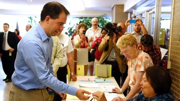 Walker prepares to cast his ballot at Jefferson School to vote in the gubernatorial recall election June 5, 2012, in Wauwatosa, Wisconsin.
