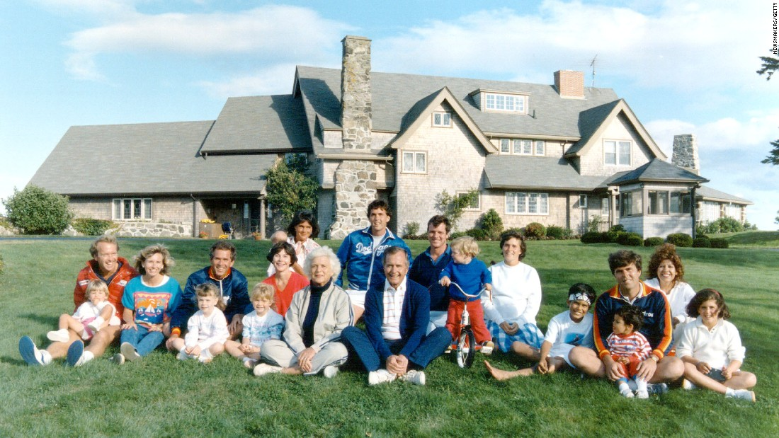 Portrait of the Bush family in front of their Kennebunkport, Maine house August 24, 1986. Pictured, back row: Margaret holding daughter Marshall, Marvin Bush, Bill LeBlond. Pictured, front row: Neil Bush holding son Pierce, Sharon, George W. Bush holding daughter Barbara, Laura Bush holding daughter Jenna, Barbara Bush, George Bush, Sam LeBlond, Doro Bush Lebond, George P. (Jeb's son), Jeb Bush holding son Jebby, Columba Bush and Noelle Bush.