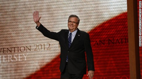 Former Florida Governor Jeb Bush waves to the audience at the Tampa Bay Times Forum in Tampa, Florida, on August 30, 2012 on the final day of the Republican National Convention (RNC).