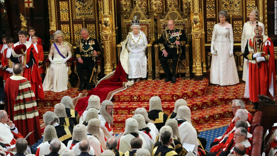Charles and Camilla, seated at the left near Queen Elizabeth II, attend the opening of Parliament together in May 2013.