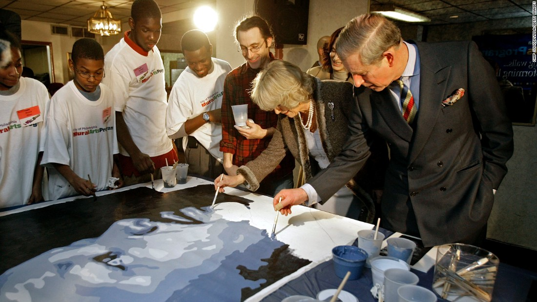 Charles and Camilla add to a mural of Martin Luther King Jr. while in Philadelphia in January 2007.