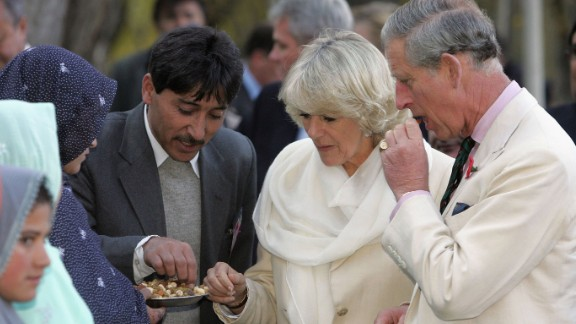 Charles and Camilla taste local food during a visit to Skardu, Pakistan, in November 2006.