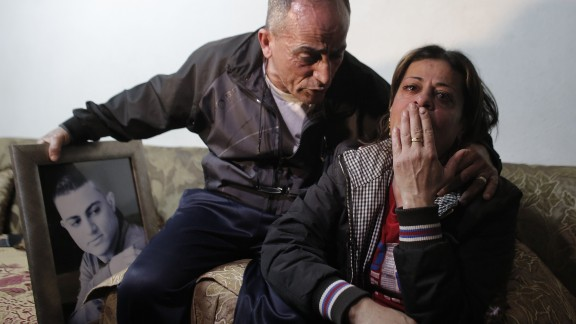 The parents of 19-year-old Mohammed Musallam react at the family's home in the East Jerusalem Jewish settlement of Neve Yaakov on Tuesday, March 10. ISIS released a video purportedly showing a young boy executing Musallam, an Israeli citizen of Palestinian descent who ISIS claimed infiltrated the group in Syria to spy for the Jewish state. Musallam's family told CNN that he had no ties with the Mossad, Israel's spy agency, and had, in fact, been recruited by ISIS.