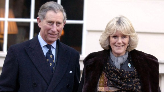 Charles and Camilla walk together in February 2003.