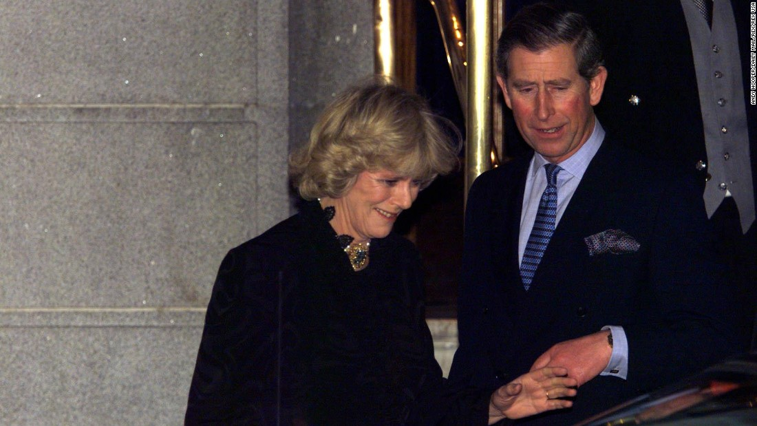 Charles and Camilla make their first public appearance as a couple after leaving a party in London in January 1999.