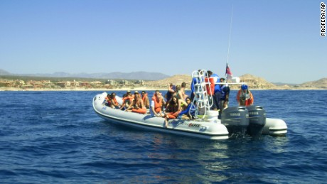 In this photo provided by the Procuraduria Federal de Proteccion al Ambiente (PROFEPA), shows a boat which collided with a grey whale near the beach resort of Cabo San Lucas, Mexico, Thursday, March 12, 2015. Mexican authorities said Thursday, March 12, 2015, that a 35-year-old Canadian woman has died and two other tourists were injured near the beach resort when a surfacing grey whale crashed onto their boat as they came back from a snorkel tour. (AP Photo/PROFEPA)