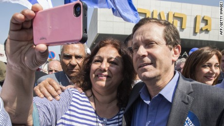 A supporter takes a selfie with Israeli Labor Party leader Isaac Herzog during campaigning on March 13, 2015.