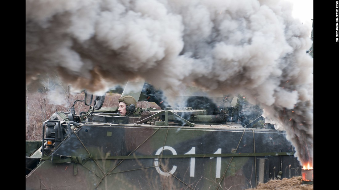 A Lithuanian soldier from 3rd Company, Algirdas Mechanized Infantry Battalion waits in an M113 armored personnel carrier during a combined live-fire exercise with U.S. troops at Pabrade training area, Lithuania, March 4, 2015.