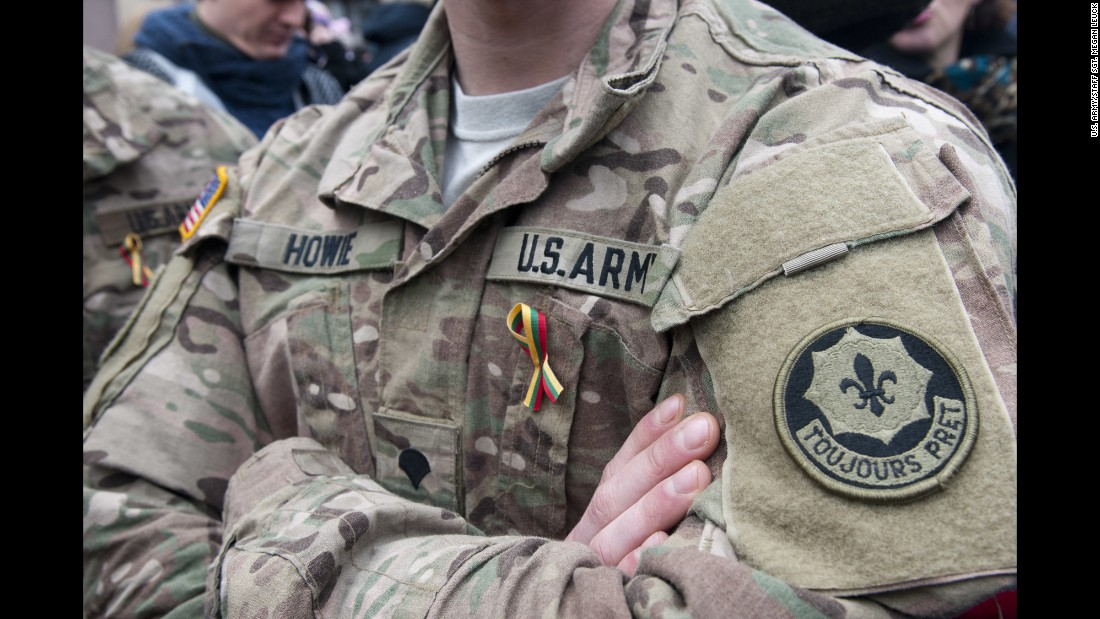 Dragoons from Lightning Troop, 3rd Squadron, 2nd Cavalry Regiment participate in Operation Atlantic Resolve. They wear ribbons representing the Lithuanian flag during an Independence Day event in Vilnius, Lithuania, March 11, 2015.