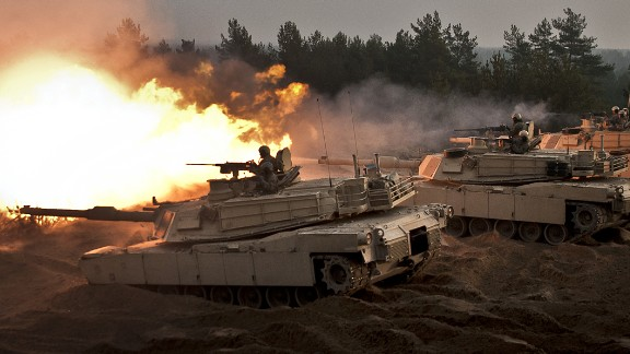 U.S. soldiers fire ceremonial rounds from M1A2 Abrams Tanks at the Adazi Training Area, Latvia, Nov. 6, 2014.