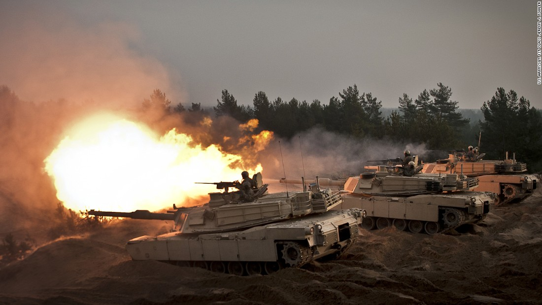 U.S. soldiers fire ceremonial rounds from M1A2 Abrams tanks at the Adazi training area, in Latvia, last November.
