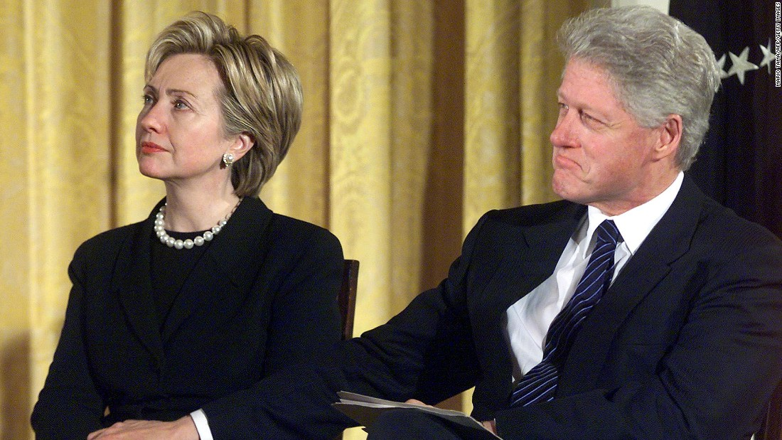 "The Clintons at a celebration of the Breast and Cervical Cancer Act of 2000 at the White House on January 4, 2001. Weeks later, on his final day in office, Bill Clinton would pardon an unusually large number of people including fugitive Marc Rich, a move that was dubbed ""Pardongate."""