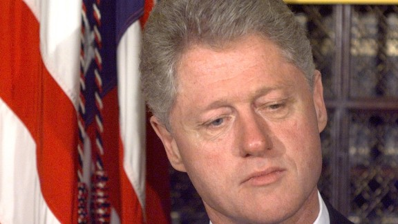 Former President Clinton stands to the side as he waits to be introduced at an event at the White House on October 8, 1998. Later that afternoon, the Republican House majority adopted a motion to launch an impeachment inquiry into Clinton's presidency.
