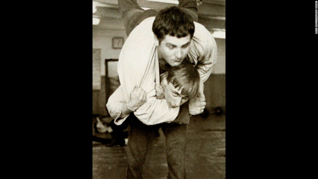 Putin, bottom, wrestles with a classmate in 1971. He went on to study law at Leningrad State University, and in 1975 he joined the KGB, a Soviet-era spy agency.