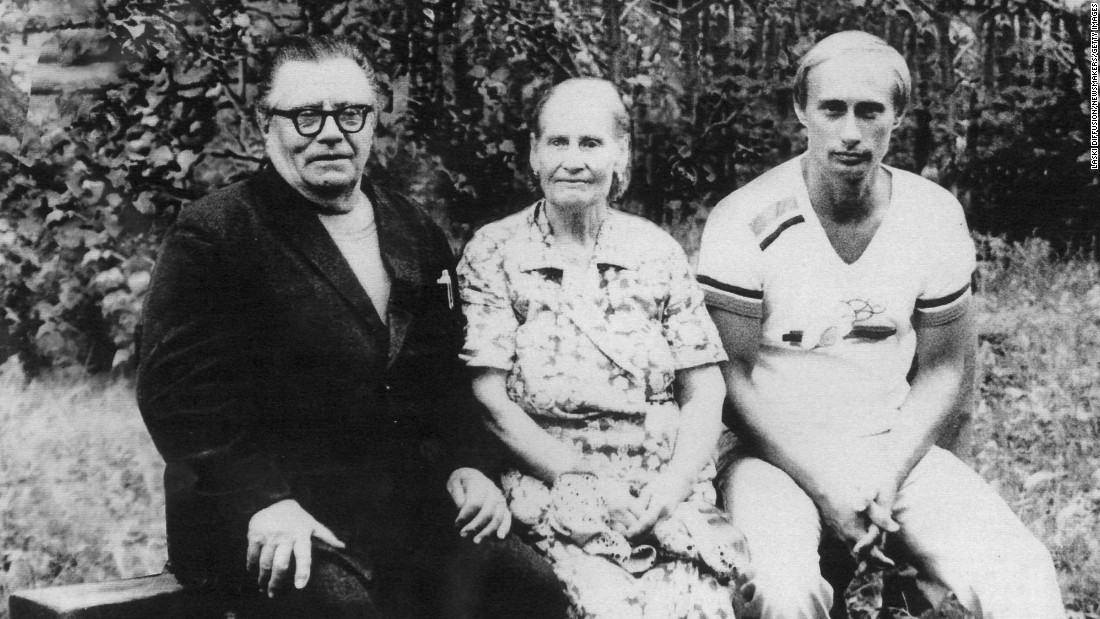 Putin poses with his parents, Vladimir and Maria, in 1985.