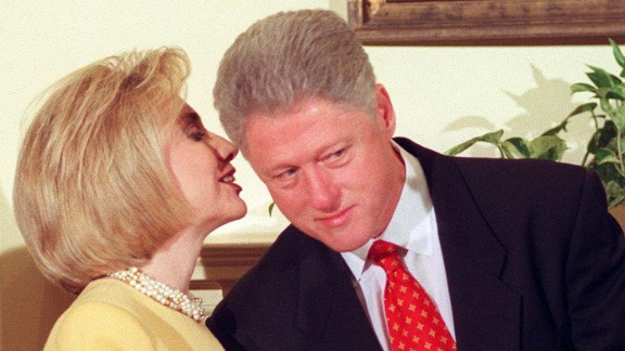 "Former President Clinton listens to Hillary during an education event at the White House on January 26, 1998. During the event, Clinton made a statement about his alleged affair with former White House intern Monica Lewinsky. The President vehemently denied the allegations, saying, ""I did not have sexual relations with that woman, Miss Lewinsky, I never told anybody to lie, not a single time."""
