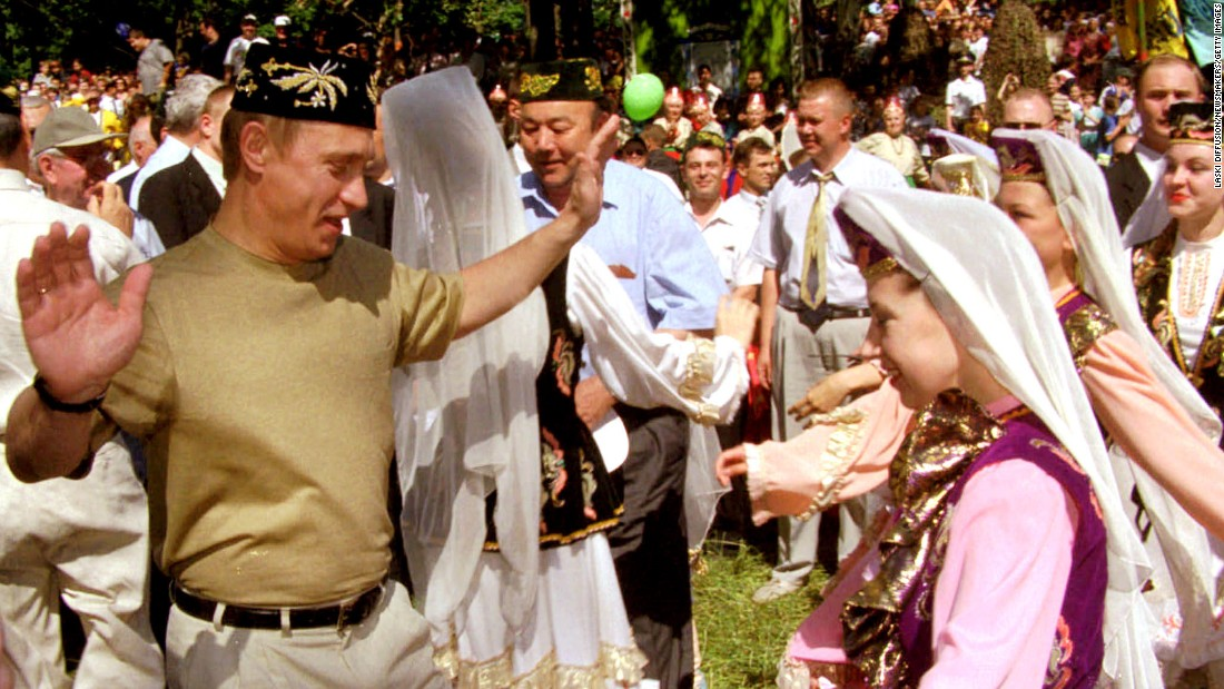 Putin dances with a young girl in Kazan, Russia, while taking part in mid-summer festivities in June 2000.