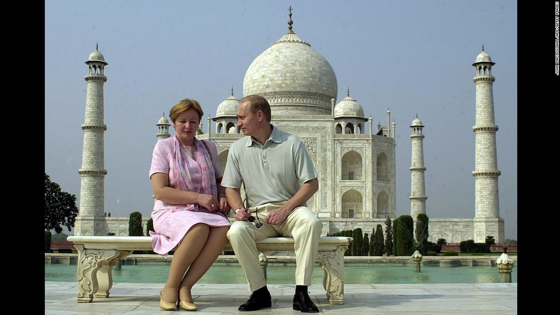 Putin speaks to his wife, Lyudmila, as they pose in front of the Taj Mahal in India in October 2000. They were married for 30 years before their divorce was finalized in 2014. They have two daughters together.