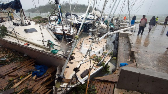This handout photo taken and received on March 14, 2015 by UNICEF Pacific shows storm damage to boats caused by Cyclone Pam, in the Vanuatu capital of Port Vila.