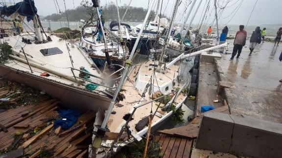 Damaged boats are seen on Saturday, March 14, in Port Vila, Vanuatu's capital.