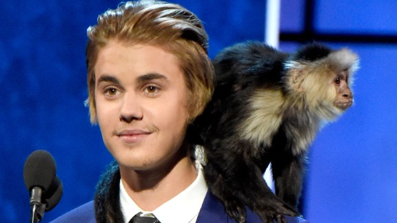 Justin Bieber and his monkey appear onstage at his Comedy Central roast.
