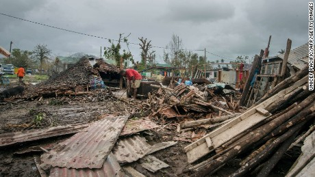 Residents work among the debris created by the cyclone outside Port Vila, Vanuatu on March 15.