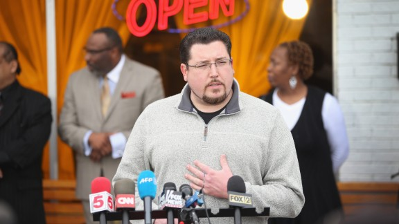 Ferguson, Missouri, Mayor James Knowles joins business owners to speak to the press outside a restaurant on March 14 in Ferguson, Missouri. The  business owners called the press conference to explain how the constant protests in the town have been detrimental to business.
