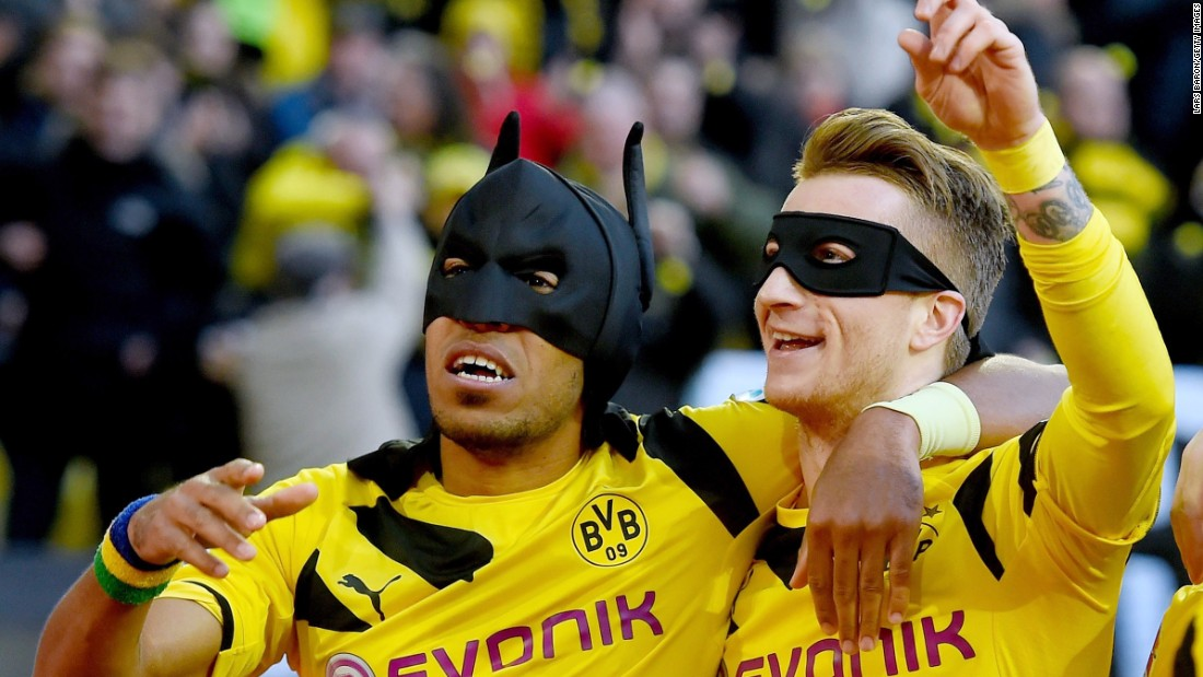 Who needs Pierre-Emerick Aubameyang and Marco Reus when you've got Batman and Robin?<br /><br />Borussia Dortmund's own dynamic duo donned masks after Aubameyang opened the scoring in the Bundesliga match against local rivals Schalke last month.<br /><br />It's not the first time Aubameyang has raided his fancy dress wardrobe after scoring. Earlier this year, he donned a Spiderman mask pulled from his shorts when he netted against Bayern Munich.