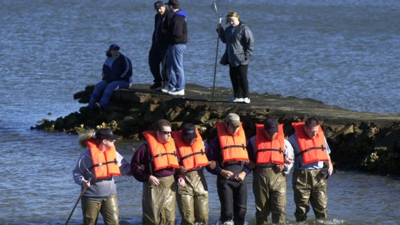 Private detectives comb a portion of Galveston Bay in search of Morris Black