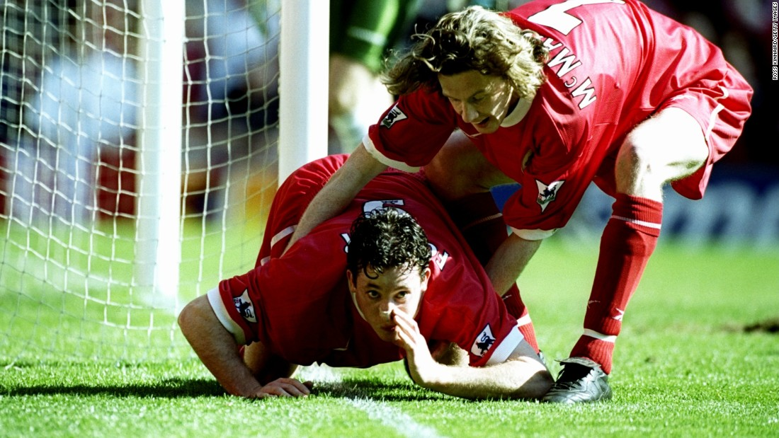 "Another up-yours to purported excess.<br /><br />Robbie Fowler of Liverpool is pulled away by team mate Steve McManaman after mimicking snorting cocaine along the white paint of the Anfield touchline to mark his first goal in an English Premier League match against Everton in 1999.<br /><br />The celebration seemed to be aimed at abusive Everton fans, although then Liverpool manager Gerard Houllier tried to sidestep the controversy by saying that Fowler was ""eating the grass."""