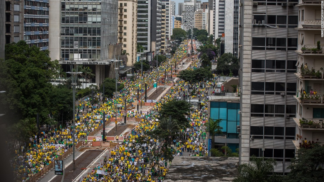 Demonstrators protest along Paulista Avenue.