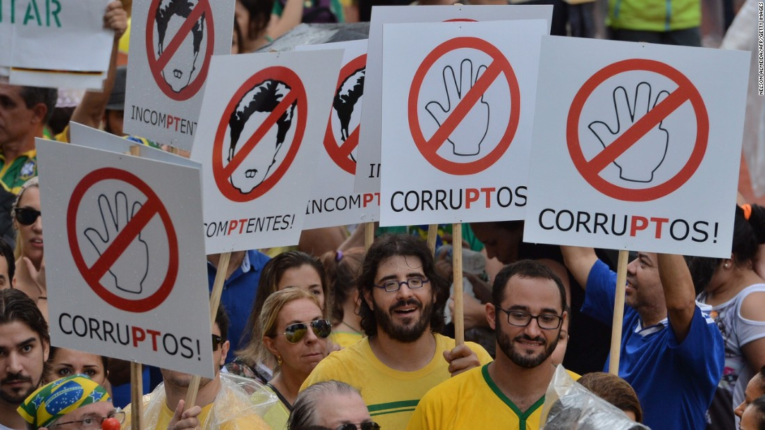 Protesters denounce corruption and demand the impeachment of Rousseff.