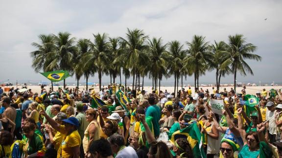 Brazilians march along Copacabana beach.