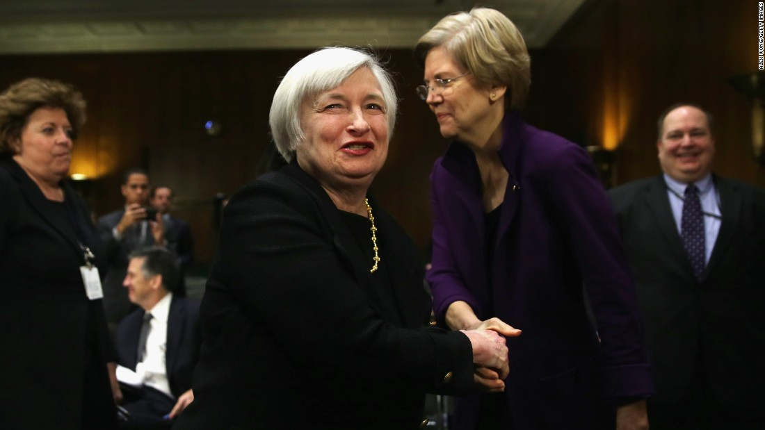 Then-nominee for the Federal Reserve Board Chairman Janet Yellen (left) shakes hands with Warren (Right) after her confirmation hearing before Senate Banking, Housing and Urban Affairs Committee on November 14, 2013, on Capitol Hill.