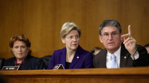 Senate Banking, Housing and Urban Affairs Committee members (right to left) Sen. Joe Manchin, Warren and Heidi Heitkamp participate in a hearing with then-Federal Reserve Bank Chairman, Ben Bernanke, after the release of The Semiannual Monetary Policy Report to the Congress on February 26, 2013, in Washington, D.C.