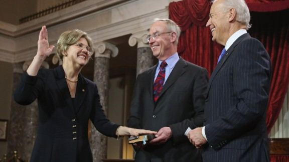 Warren participates in a ceremonial swearing-in with her husband Bruce Mann and Vice President Joe Biden in the Old Senate Chamber on January 3, 2013, in Washington, D.C.