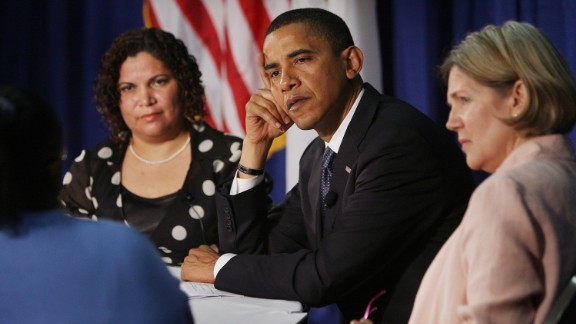Then-Democratic presidential candidate Barack Obama (center) listens to questions with Rosa Figueroa (left) and Warren while hosting an economic round table at the Illinois Institute of Technology on June 11, 2008, in Chicago.