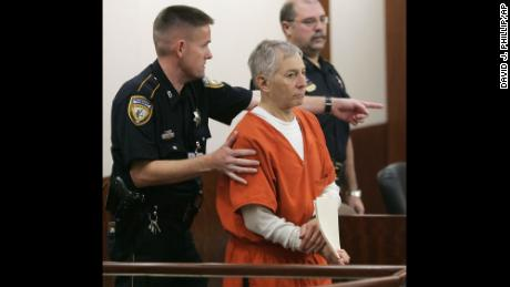 Robert Durst is escorted into the courtroom for a parole revocation hearing held by the Texas Board of Pardons and Paroles, Friday, Jan. 13, 2006, in Houston. The parole officer for the New York real estate heir acquitted of murdering his Galveston neighbor recommended the eccentric millionaire be housed in a prison facility for parole violators after he made unscheduled trips to Galveston and Houston that were against the terms of his release.